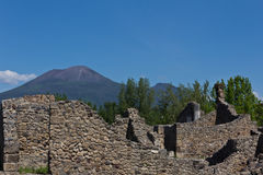 Excavated ruins of Pompeii and Mount Vesuvius in the background Royalty Free Stock Photo
