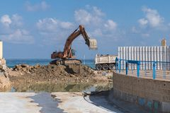 Excavating enable better water steaming. This excavating site is to enable a better stream of water to sea Royalty Free Stock Images