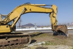 Excavating. Excavator on the road royalty free stock image