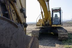 Excavating. Excavator on the road royalty free stock photo