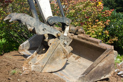 Excavating machine. For digging and landscaping royalty free stock photos