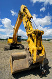 Excavating Machine. Very Large Earth Moving Excavating Machine On A Construction Site stock photography