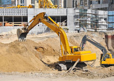 Excavating machine on construction site Stock Images