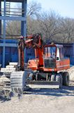 Excavating machine on construction site. Work of excavating machine on building construction site royalty free stock photo