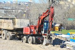 Excavating machine on construction site. Work of excavating machine on building construction site stock photos
