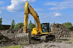 Excavating machine moves earth Royalty Free Stock Images