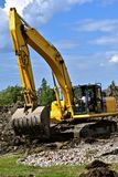 Excavating machine moves earth Royalty Free Stock Photo