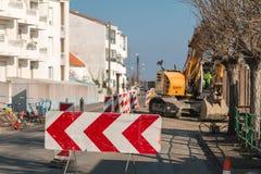 Excavating machine in roadworks Stock Images