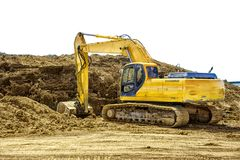 Excavating machinery at a construction site, on white. Excavating machinery at a construction site, on a white background. Copy space for your text or your royalty free stock image