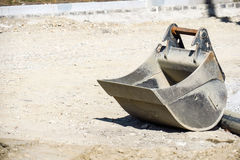 Excavation bucket. Excavator shovel at a construction site with copy space to the left Stock Images