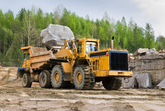 Excavation and dump vehicle. In a granite quarry Royalty Free Stock Photo