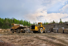 Excavation and dump vehicle. In a granite quarry Royalty Free Stock Image
