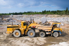 Excavation and dump vehicle. In a granite quarry Royalty Free Stock Images