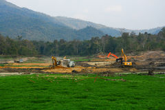 Excavation. Lamphun, Thailand - Febuary 7 2015 : The machine excavate soil in field Royalty Free Stock Images