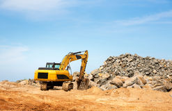 Excavation mashine works in a quarry Royalty Free Stock Images
