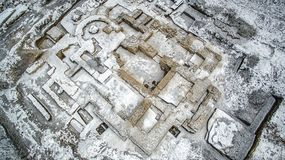 Excavation of an old orthodox temple. Excavations of the old Orthodox church in the winter from the air Royalty Free Stock Images