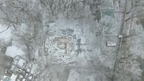 Excavation of an old orthodox temple. Excavations of the old Orthodox church in the winter from the air stock video