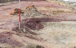 Excavation pit with sand and gravel. And rod for height measurement Royalty Free Stock Photography