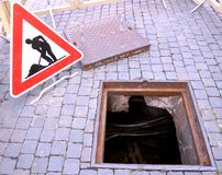 Excavation and repair work and the signal. Manhole opened for excavation and repair the cable and the signal of caution Stock Image
