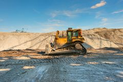 Excavation site with construction machine Royalty Free Stock Photos