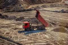 Excavation site with construction machine Royalty Free Stock Images