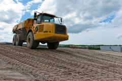 Excavation truck. Is loaded with sand Royalty Free Stock Photo