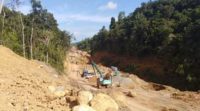 Excavation using machines in the forest area stock image