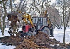 Excavation work on accomplishment of city park Stock Photos