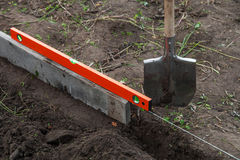 Excavation work on the farm. Preparing beds for planting seedlings Royalty Free Stock Photography