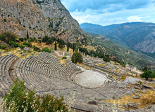 Excavations of the ancient Delphi city (Greece). Excavations of the ancient Delphi city along the slope of Mount Parnassus (Greece). The amphitheater, seen from Stock Photo
