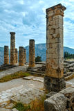 Excavations of the ancient Delphi city (Greece). Excavations of the ancient Delphi city along the slope of Mount Parnassus(Greece). The remaining columns of the Royalty Free Stock Photography
