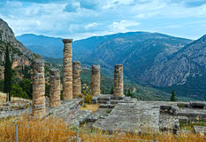 Excavations of the ancient Delphi city (Greece). Excavations of the ancient Delphi city along the slope of Mount Parnassus(Greece). The remaining columns of the Stock Image