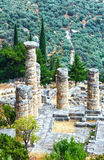 Excavations of the ancient Delphi city (Greece). Excavations of the ancient Delphi city along the slope of Mount Parnassus(Greece). The remaining columns of the Stock Photo