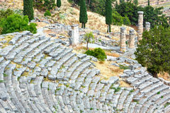 Excavations of the ancient Delphi city (Greece). Excavations (amphitheater ruins) of the ancient Delphi city along the slope of Mount Parnassus (Greece Royalty Free Stock Image