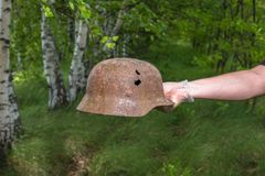 Digging in the forest. The German helmet M35. Imitation. WW2 recovery. Russia. stock photography
