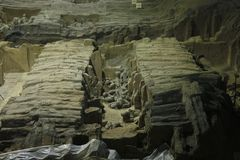 Excavations of terracotta army. China, Xi`an: Archaeological excavations of the clay army of the emperor Qin Shi Huang. The terracotta army is a figure of stock images