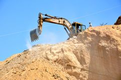 Excavatoin working in quarry Stock Image