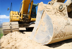 Excavator. Yellow excavator, digger on blue sky Royalty Free Stock Photography
