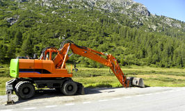 Excavator. At a road construction site Stock Photo
