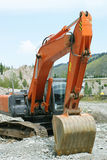 Excavator. Big excavator or digger on a building site Royalty Free Stock Image