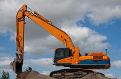 Excavator. An excavator on high ground stock image