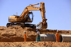 Excavator. Digging a trench for a pipe line Stock Images