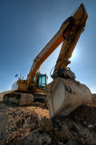 Excavator. At a construction site a sunny day Stock Photos
