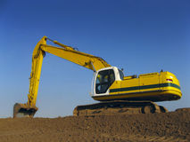 Excavator. An Excavator against a blue sky Stock Images