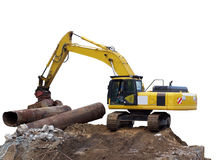 Excavator. With the work on an earth hill , pipe,isolated royalty free stock photo