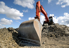 Excavator. On a hill at a construction site Royalty Free Stock Photo