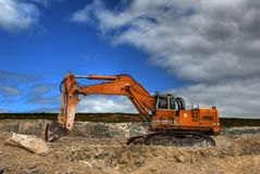 Excavator. In a limestone quarry Royalty Free Stock Images