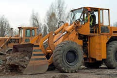 Excavator. Photo of excavator and operator of it royalty free stock photography