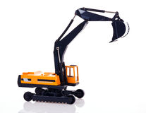 Excavator. Toy excavator isolated on white background Royalty Free Stock Photos