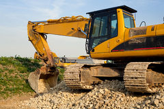 Excavator. Parked by the construction site stock image